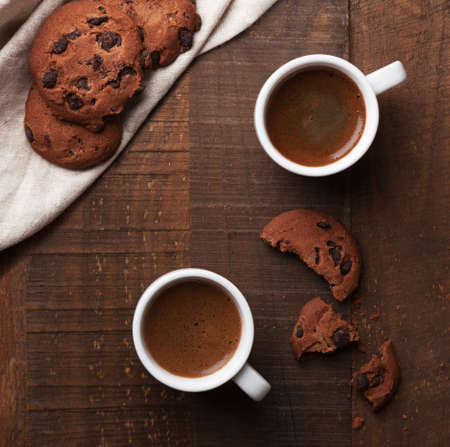 spread: Two cups of coffee on old wooden table. Stock Photo