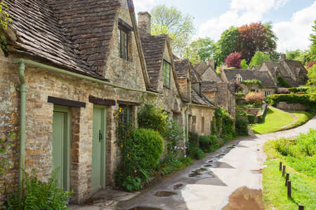 typically british: Old street with traditional cottages in  beautiful spring day , Bibury, England, UK. Stock Photo