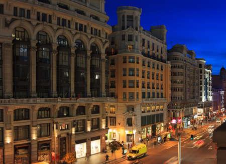via: Gran Via street at late evening, Madrid, Spain.