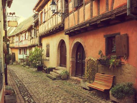 northeastern: Winding street in Eguisheim, north-eastern France.  Toned image Stock Photo