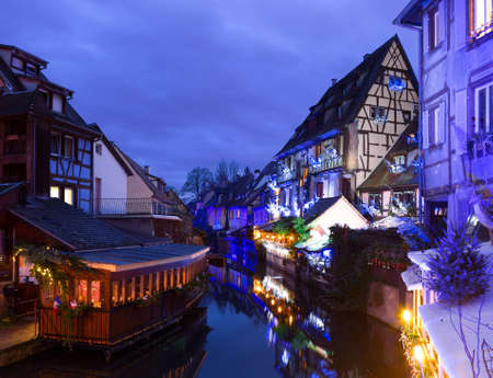 the little venice: Old houses  illuminated at night in winter, Colmar, France