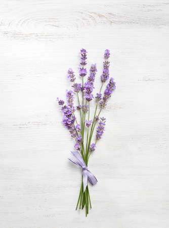Bundle of lavender on old wooden board painted white. Reklamní fotografie