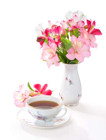 Still life with cup of tea and flowers (Alstroemeria)