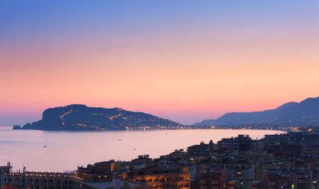 Cityscape of Alanya  at  the sunset, Turkey. At the background  Alanya Peninsula Stock Photo