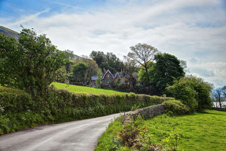 lake district england: Road  through the countryside,  Lake District National Park, Cumbria, England, UK. Stock Photo