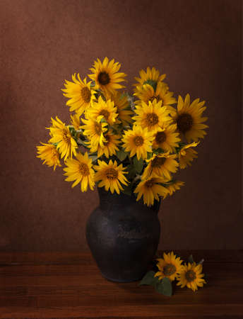 Sunflowers on old wooden table.