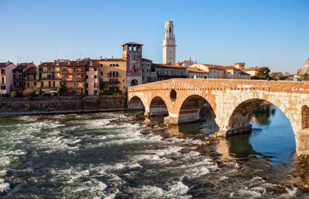 Ponte Pietra (Pons Marmoreus) and the River Adige  at  sunny morning, Verona, Italy.