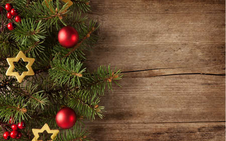 Fir branch with Christmas decorations on the background of  old grunge wooden board Stock Photo