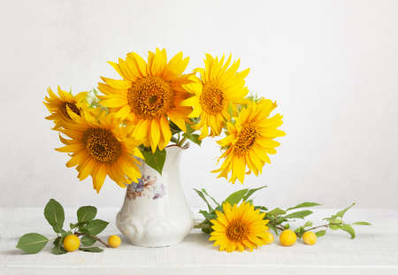 Still Life With Bouquet Of Sunflowers And Cherry Plums Stock Photo