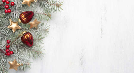 Christmas decorations and fir tree on white shabby wooden background. Archivio Fotografico