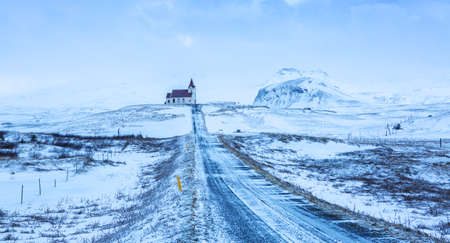 Road to Ingjaldsholl Church  during snowstorm, close to Hellissandur, Snaefellsnes peninsula, Iceland. 스톡 콘텐츠