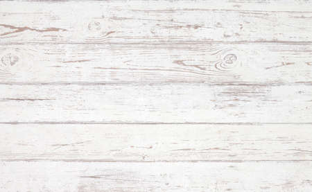 Grunge background. White wooden texture.  Peeling paint on an old wooden floor.