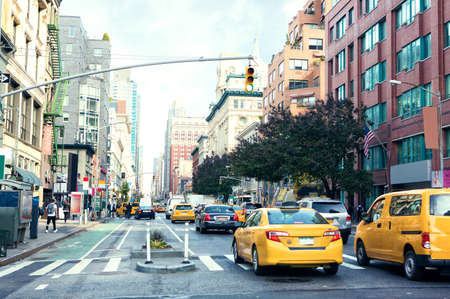 Traffic on Manhattan's avenue  ( Ladies' Mile Historic District) in the daytime, New York City,  United States.  Toned image.