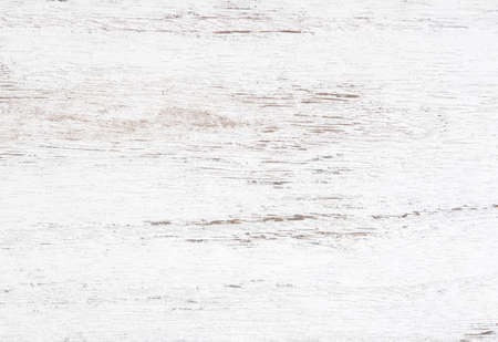 Grunge background. Peeling paint on an old wooden table. White wooden texture for background.  Top view. Imagens