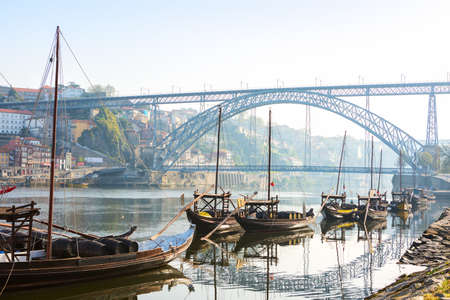 Traditional  boats in the morning on river Douro with Porto city in the background, Portugal.