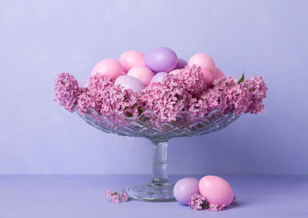 Retro still life with Easter eggs and flowers of Lilac.