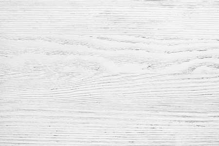 Old wooden board painted white.  Aged wood texture for background.