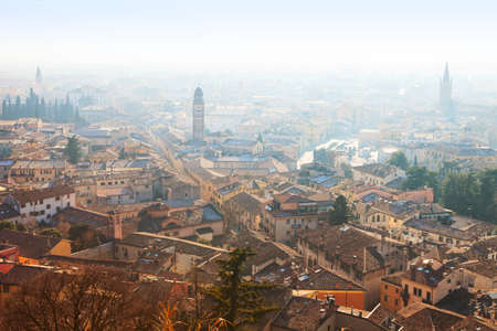 View of Verona city in a foggy morning, Italy.