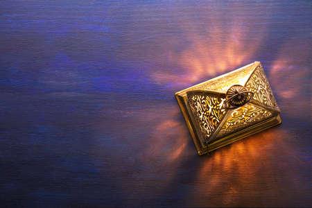 Ramadan lantern on dark blue wooden background. Ramadan background.