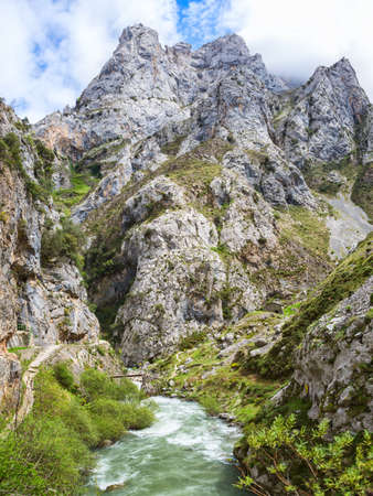 View from hiking trail (Cares Trail or Ruta del Cares) along river Cares in spring ( near  Cain), Picos de Europa National Park,  province of Leon,  Spain. Imagens