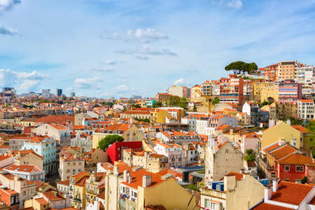 Panorama of the old town in Lisbon in sunny spring day, Portugal. The Mouraria and Graca historical districts.