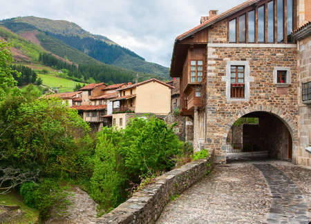 Picturesque view on street with old houses in Potes, Cantabria, Spain.