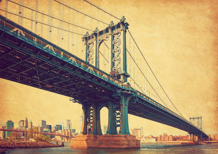 The Manhattan Bridge, New York City, United States. In the background  Manhattan and  Brooklyn Bridge. Photo in retro style. Added paper texture. 写真素材