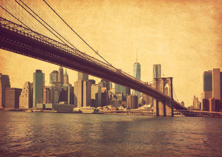 Brooklyn Bridge and Lower Manhattan  in New York City, United States. Photo in retro style. Added paper texture.
