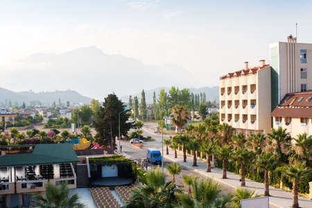 Street of Camyuva village,  with view of the mountains, district of Kemer,  Antalya Province on the Mediterranean coast of Turkey. 免版税图像