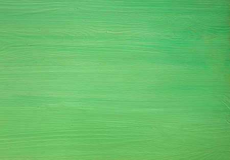 Green painted wooden background. Top view 免版税图像