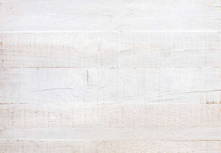 Uncouth wooden board painted white. Grunge background. Old wooden shabby texture. Flat lay. 免版税图像