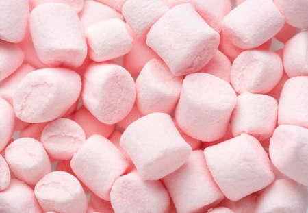 Mini marshmallows of  light pink colors. Selective Focus. Flat lay. 免版税图像