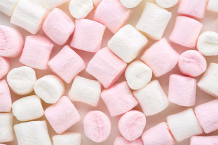 Mini marshmallows of white and light pink colors. Selective Focus. Flat lay. Reklamní fotografie