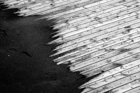 abandoning: Sand on a wooden floor Stock Photo