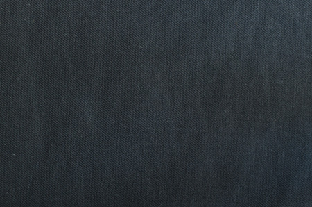 synthetic fiber: Black polyester fabric texture . Cotton
