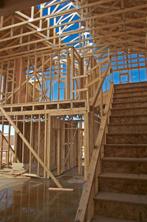 Framing of a two story house.