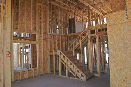 roof framing: Staircase inside a house construction.