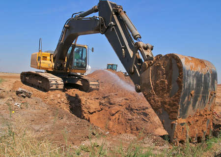 earthmover: Excavator on construction site.
