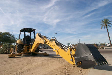 back hoe: Back hoe with outstretched scoop.