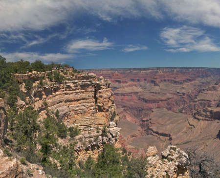Tourists at the rim of Grand Canyon photo