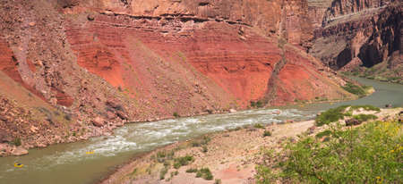 rafters: Rafters going through Hance Rapids in Grand Canyon.