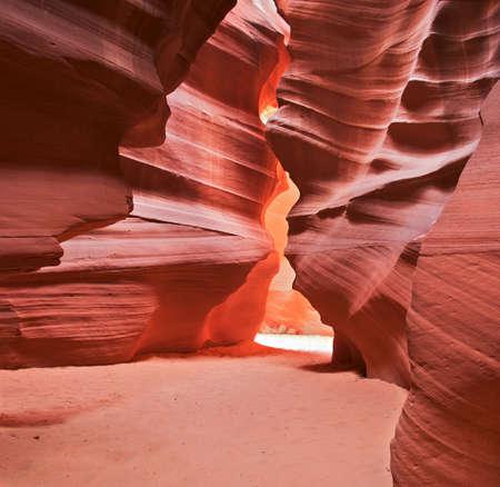 Sun rays illuminate bottom of Antelope Canyon. Фото со стока
