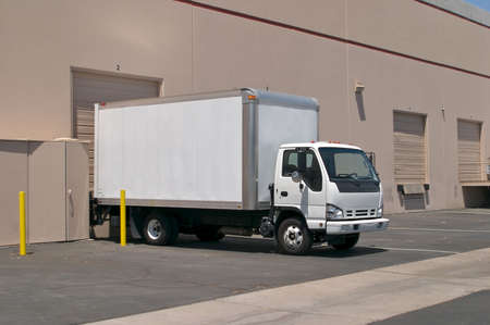 White delivery truck, at a loading dock. Stock Photo