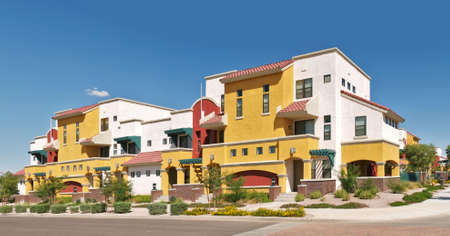 realty residence: Very colorful apartment condominium complex. Stock Photo