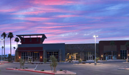 Stores at dawn, with red sunrise lit clouds.