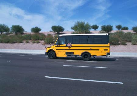 School bus on a highway., Banco de Imagens