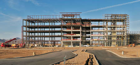 Five story buildings steel frame under construction. photo