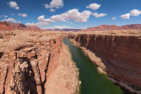paria: Colorado River  in Marble Canyon surrounded by cliffs.