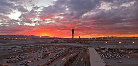 arizona sunset: Airport at sunset with lit city skyline. Stock Photo