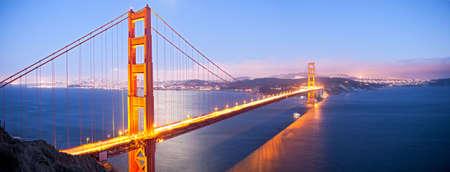 bridge: Golden Gate Bridge at dusk, with San Francisco in back.